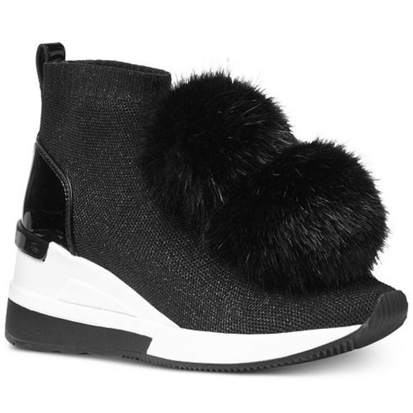 8ba75945edb MICHAEL Michael Kors Skyler Wedge Sneaker Booties.  M 5c6dc068534ef9482d88e7a1